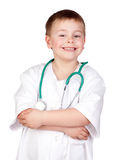 Adorable child with doctor uniform Royalty Free Stock Photos