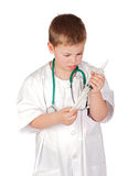 Adorable child with doctor uniform Royalty Free Stock Photography