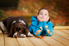 Adorable child and dog. Little boy outdoors in the fall with his pet springer spaniel dog Stock Images