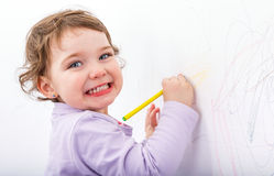 Adorable child drawing on the wall. Photo of adorable child drawing on the wall Royalty Free Stock Photo
