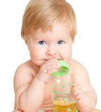 Adorable child drinking from bottle. 6 months old girl Royalty Free Stock Photos