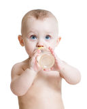 Adorable child drinking from bottle Stock Images