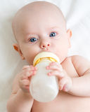 Adorable child drinking from bottle Stock Photos