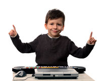 Adorable child with electric piano and laptop Royalty Free Stock Photos
