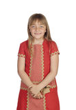 Adorable child with a elegant red dress Royalty Free Stock Image