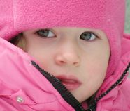 Adorable Child face. Adorable Beautiful child face in winter with snow Royalty Free Stock Image