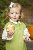 Adorable Child Girl Eating Red Apple Outside Stock Photo