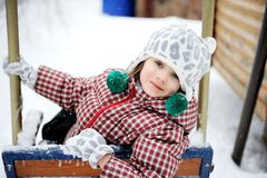 Adorable Child Girl Enjoys Seesaw In Winter Royalty Free Stock Photos