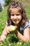 Adorable child girl with flower. Summer green nature Royalty Free Stock Photography
