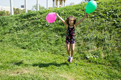 Adorable child girl with flower. Summer green nature Royalty Free Stock Photo