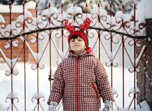 Adorable Child Girl In Horned Hat Poses Outdoors Stock Photo