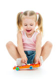 Child playing with musical toy Royalty Free Stock Photo