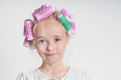 Adorable child girl portrait in curlers Royalty Free Stock Images