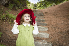 Adorable Child Girl with Red Hat Playing Outside Stock Photos