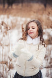 Adorable child girl on the walk in winter forest Stock Images