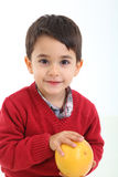 Adorable child with a grapefruit. A child with a grapefruit on white background Royalty Free Stock Images