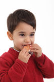 Adorable child with a grapefruit. Child eating grapefruit on white background Stock Photo