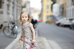 Adorable child having fun in a city Stock Photo