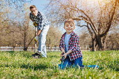Adorable child having fun with dad in backyard royalty free stock photos