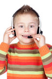 Adorable child with headphones Stock Photo