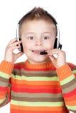 Adorable child with headphones stock photo