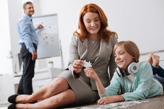 Adorable child and her mom finding matching pieces Royalty Free Stock Photography