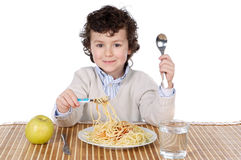 Adorable child hungry at the time of eating Royalty Free Stock Photos