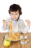 Adorable child hungry at the time of eating Royalty Free Stock Images