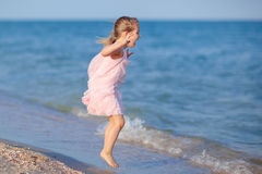 Adorable child jumping at the beach Stock Photos