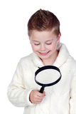 Adorable child with a magnifying glass Royalty Free Stock Image