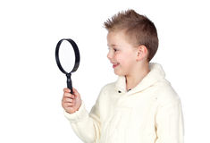 Adorable child with a magnifying glass Royalty Free Stock Photography
