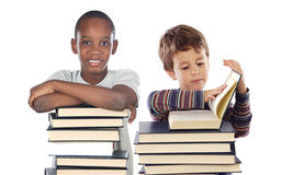 Adorable child with many books Stock Image