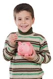 Adorable child with moneybox savings. Isolated over white Royalty Free Stock Image