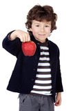 Adorable child with one apple Stock Images