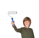 Adorable child with a paint roller Royalty Free Stock Images