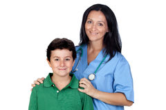 Adorable child with a pediatrician woman stock image