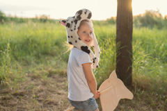 Adorable child play outdoors Stock Photo