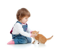 Adorable child playing with cat kitten Stock Photo