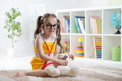 Adorable child playing doctor in daycare Royalty Free Stock Photos