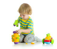 An adorable child playing with educational isolated on white. Stock Image
