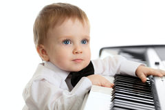 Adorable child playing electron piano. Over white Stock Photography