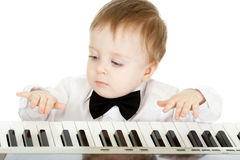 Adorable child playing electronic piano Stock Image