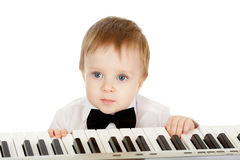 Adorable child playing electronic piano Stock Photos