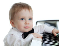 Adorable child playing electronic piano Royalty Free Stock Photography
