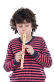 Adorable child playing flute Royalty Free Stock Images