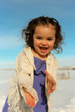 Adorable child playing outside. Adorable little girl playing outside on a warm winter day Royalty Free Stock Photography