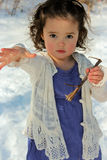 Adorable child playing outside. Adorable little girl playing outside with a stick Stock Photos