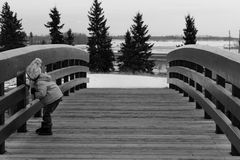 Adorable child playing outside. Adorable little girl playing outside on a bridge Royalty Free Stock Photos