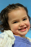 Adorable child playing outside. Adorable little girl playing outside and smiling Royalty Free Stock Image