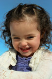 Adorable child playing outside. Adorable little girl playing outside and smiling Royalty Free Stock Photos
